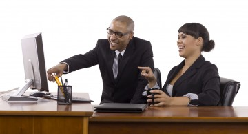 Kozzi-happy-business-people-pointing-on-the-computer-1674 X 1254
